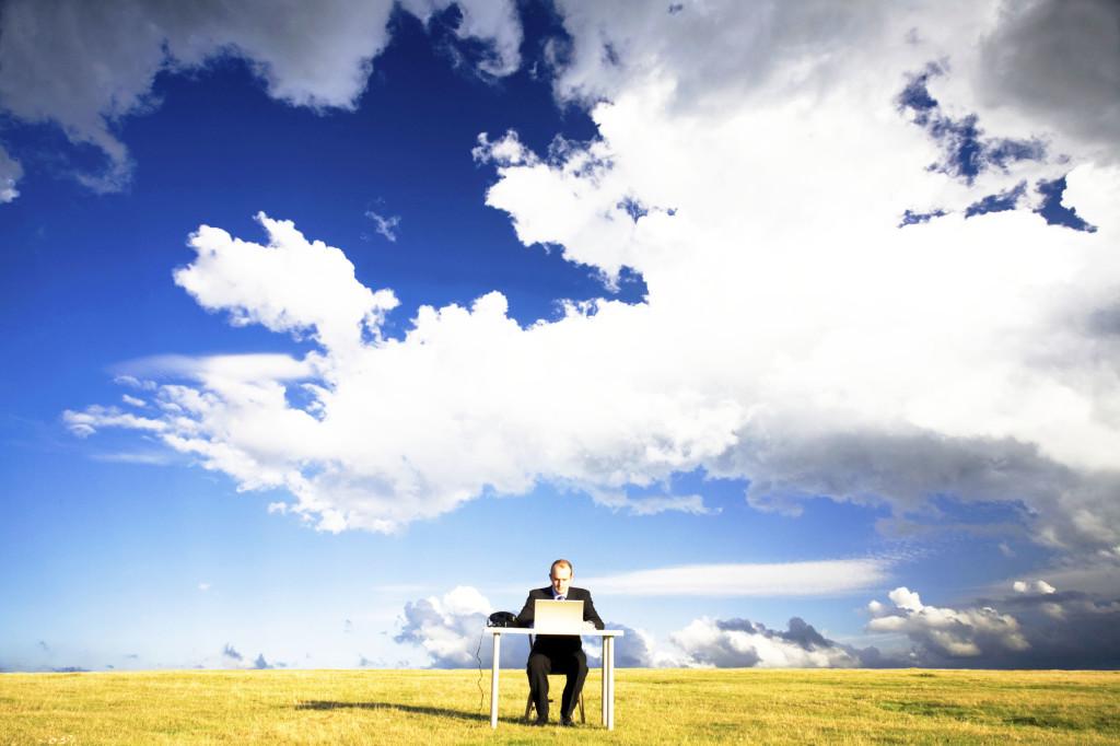 Guy on lap top in field